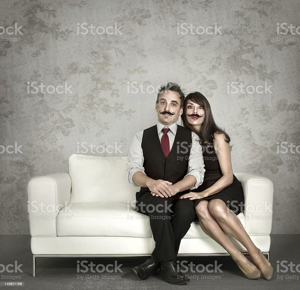 Couple wearing fake mustaches royalty-free stock photo
