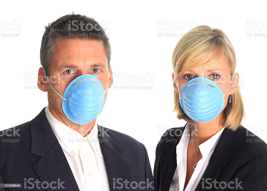 Couple wearing flu masks royalty-free stock photo