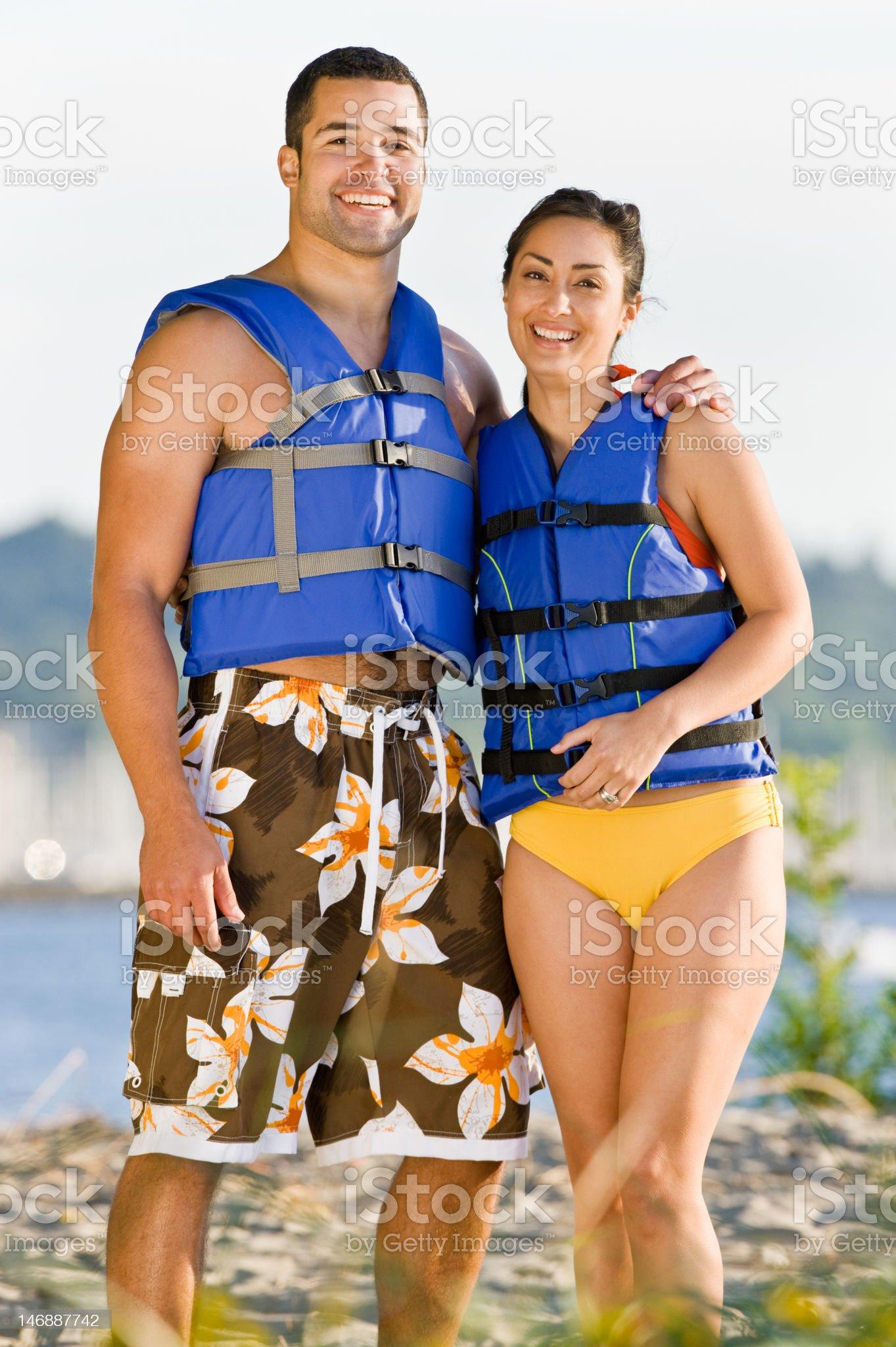Couple Wearing Life Jackets at Beach royalty-free stock photo