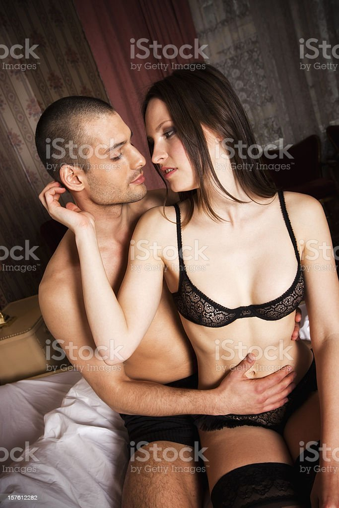 Couple wearing underwear and kissing royalty-free stock photo