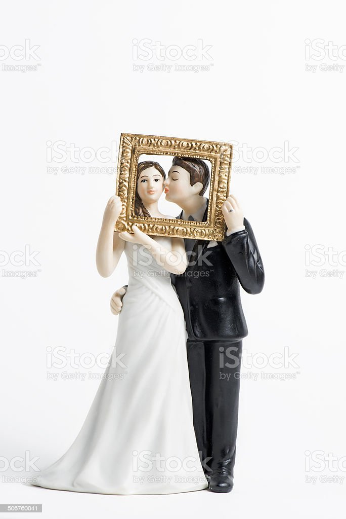 Couple wedding cake topper isolated stock photo