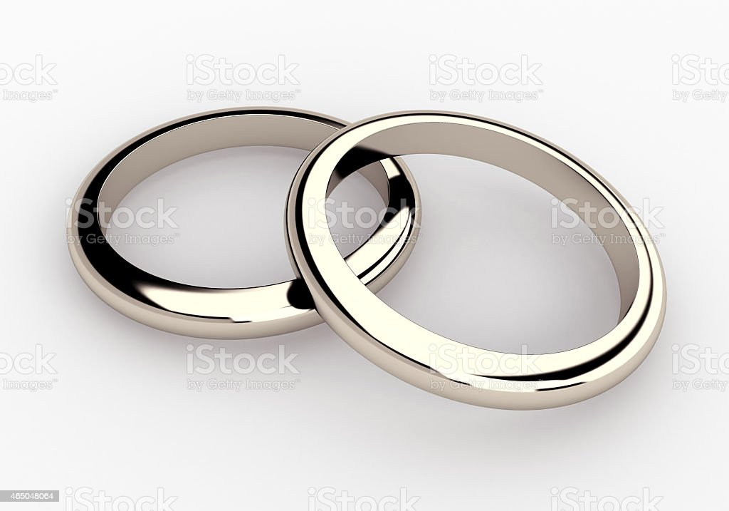 couple white gold, platinum wedding rings in isolated background stock photo