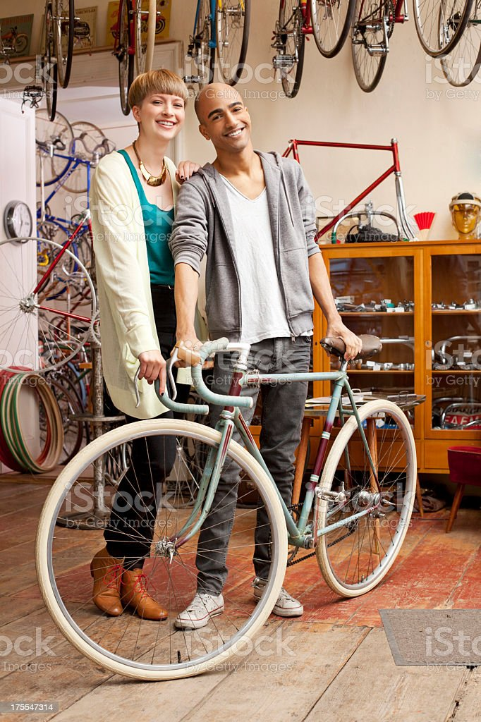 Couple who just purchased a new bicycle stock photo