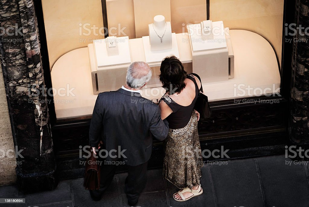 Couple window shopping royalty-free stock photo
