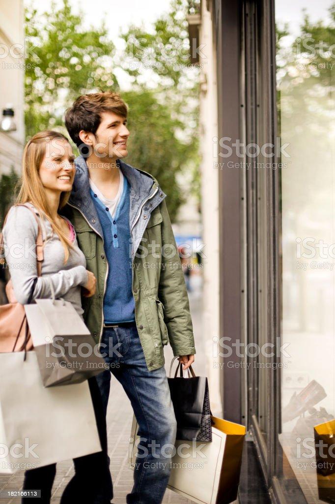 Couple window shopping royalty-free stock photo