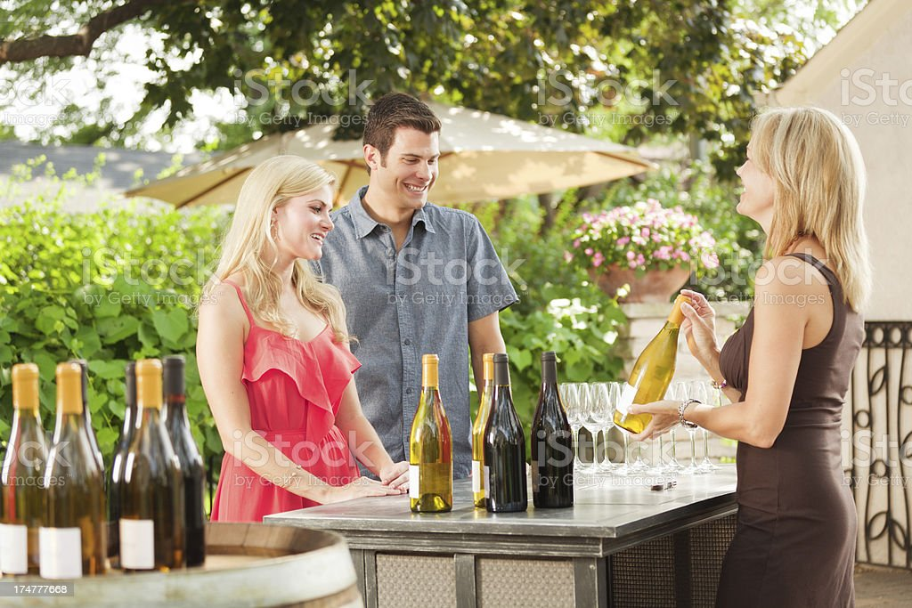 Couple Winetasting, Tasting Wine Country Winery Bottles Selection by Vineyard royalty-free stock photo