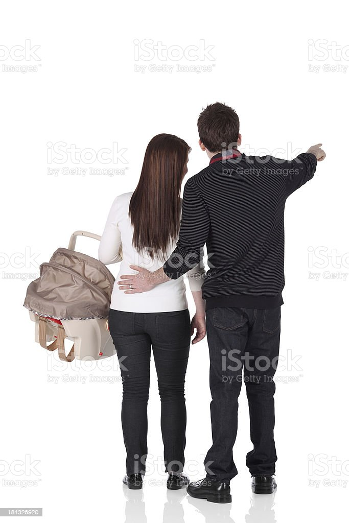 Couple with a baby seat royalty-free stock photo