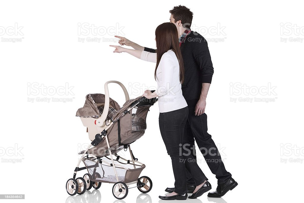 Couple with a baby stroller stock photo