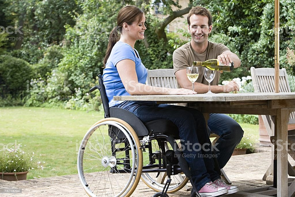 Couple with a bottle of wine stock photo