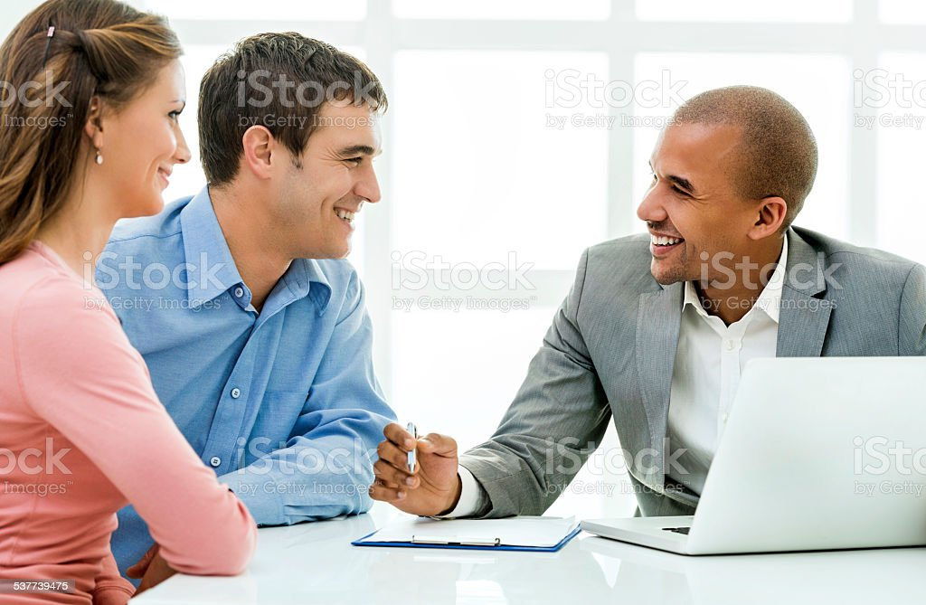 Couple with a financial advisor. stock photo
