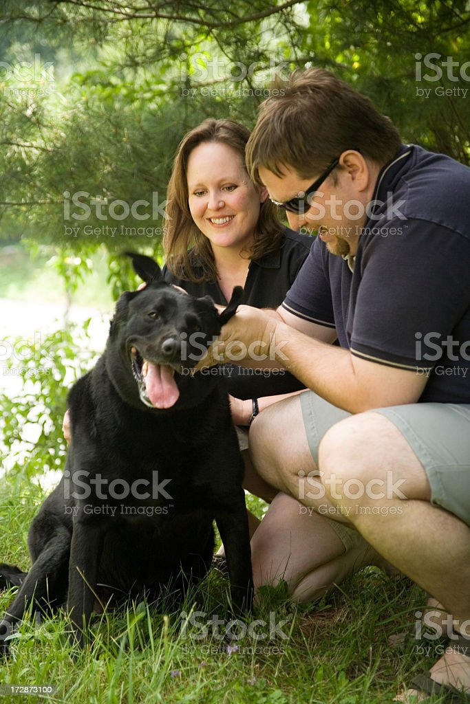 Couple With A Lab royalty-free stock photo