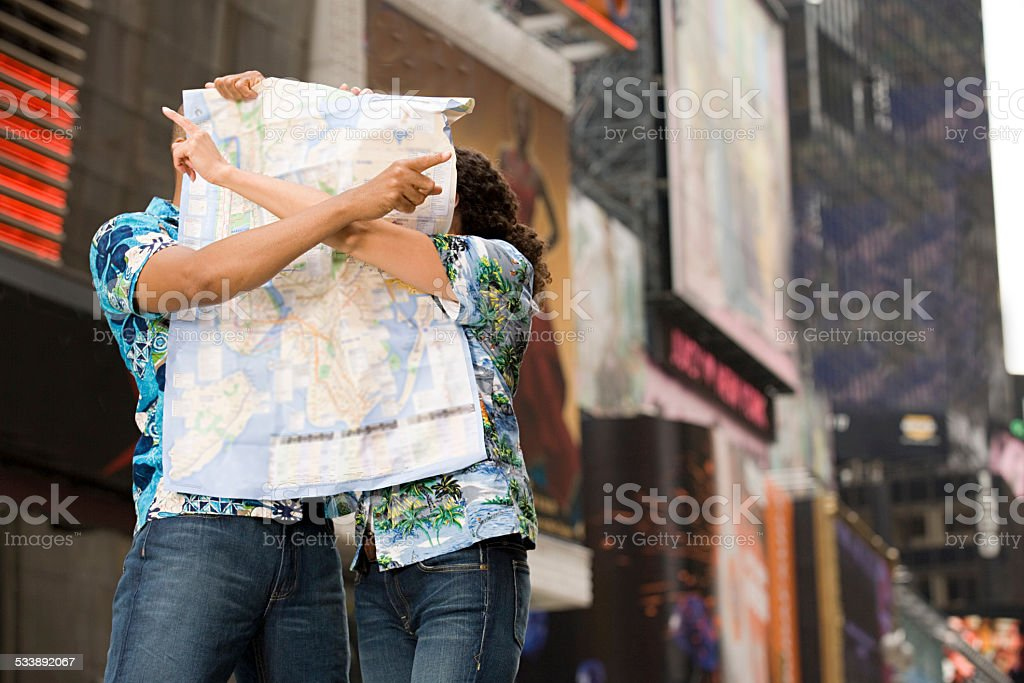 Couple with a map stock photo
