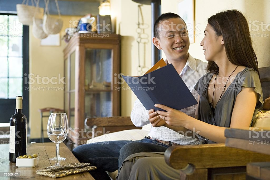 Couple with a menu royalty-free stock photo