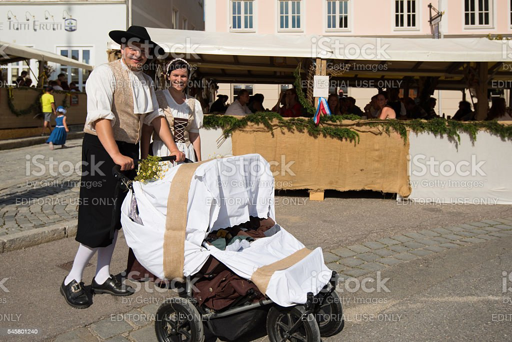 Couple with baby at historic festival stock photo