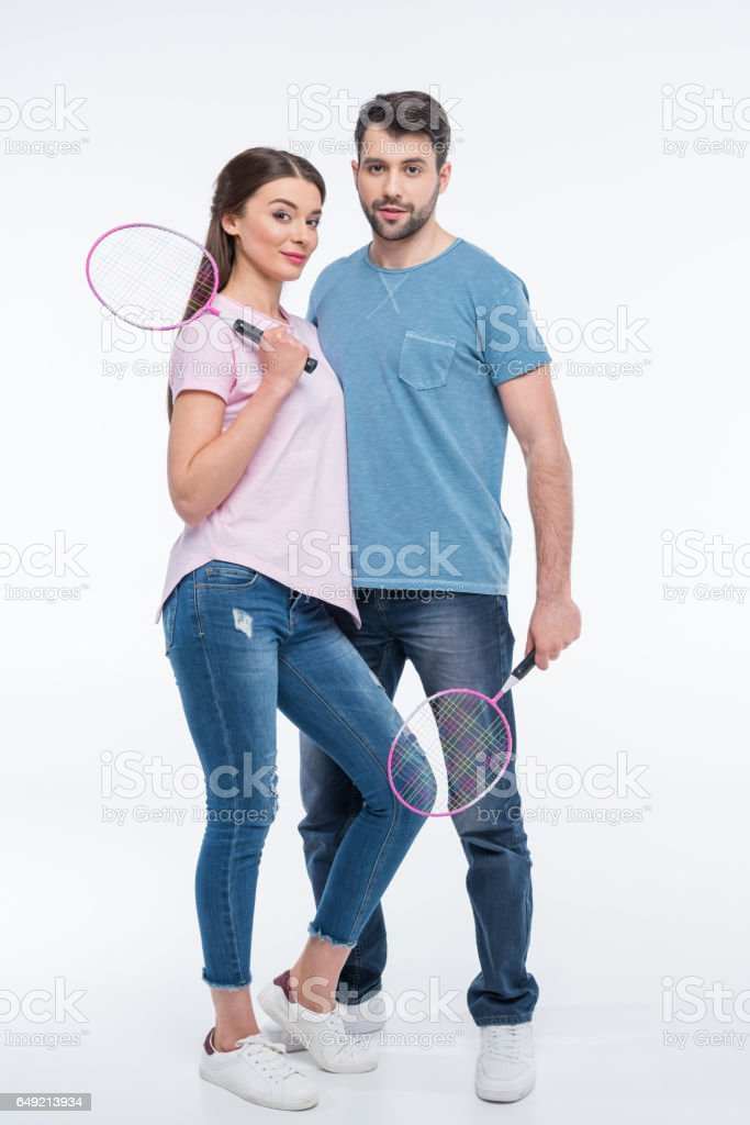 couple with badminton rackets in hands on white stock photo