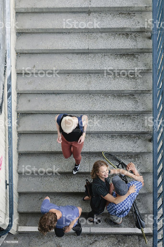 Couple with Bicycle hugging on S-Bahn Stairs royalty-free stock photo