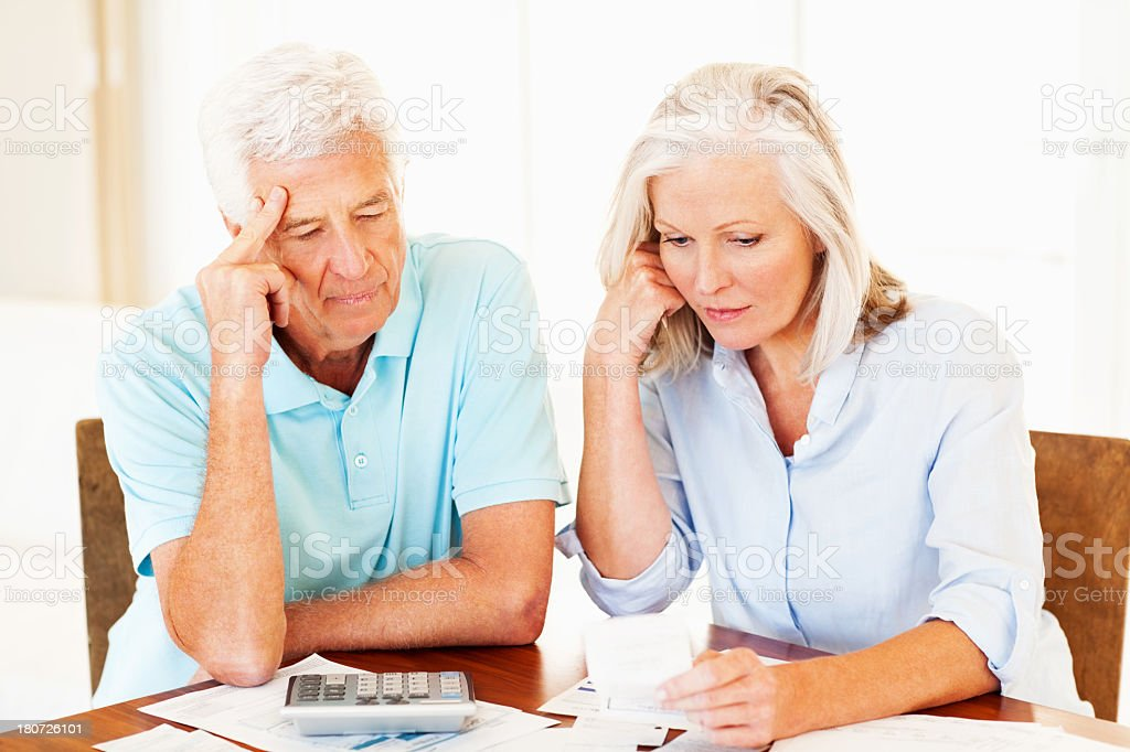Couple With Bills Calculating Home Finances royalty-free stock photo