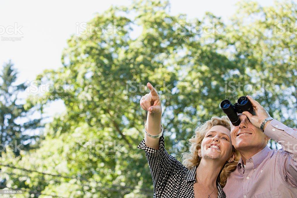 Couple with binoculars stock photo