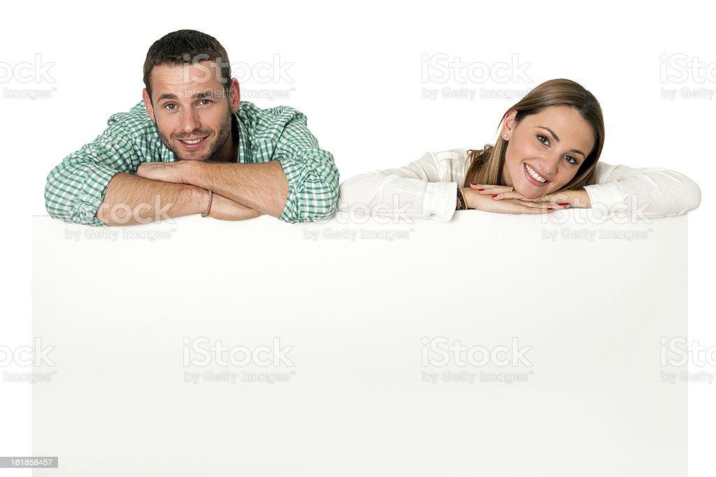 Couple avec blank repasser pour les publicités. photo libre de droits