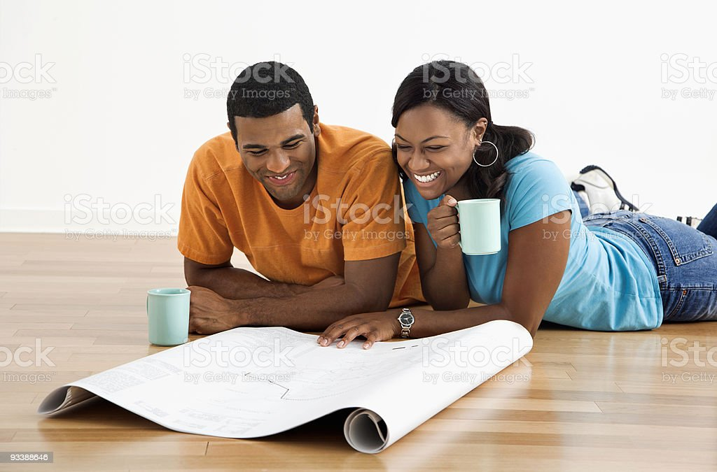 Couple with blueprints. royalty-free stock photo