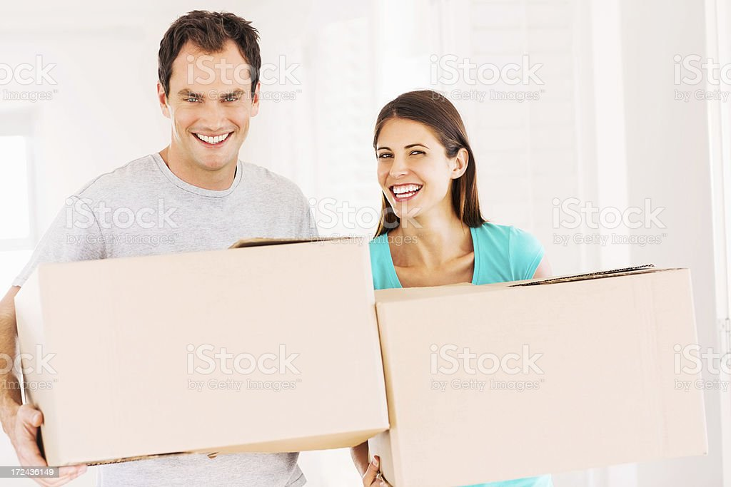 Couple With Cardboard Boxes In New House royalty-free stock photo
