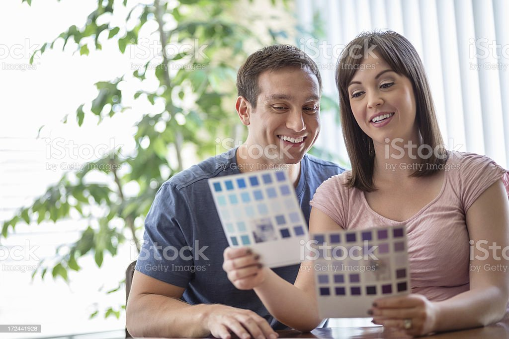 Couple With Catalog Choosing Color At Home stock photo