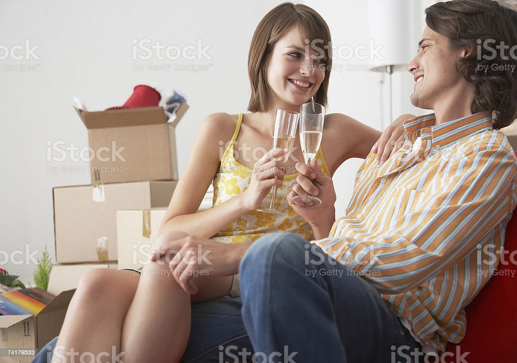 Couple with champagne in house celebrating royalty-free stock photo
