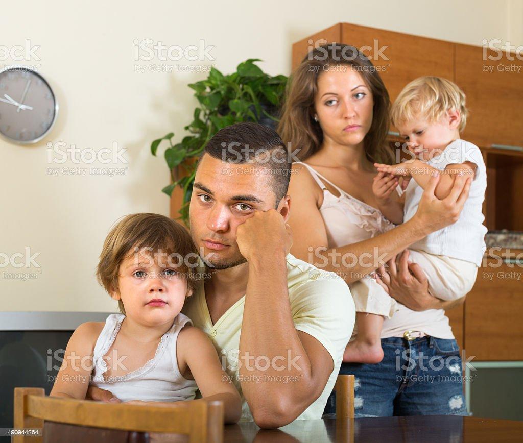 Couple with children having quarrel stock photo