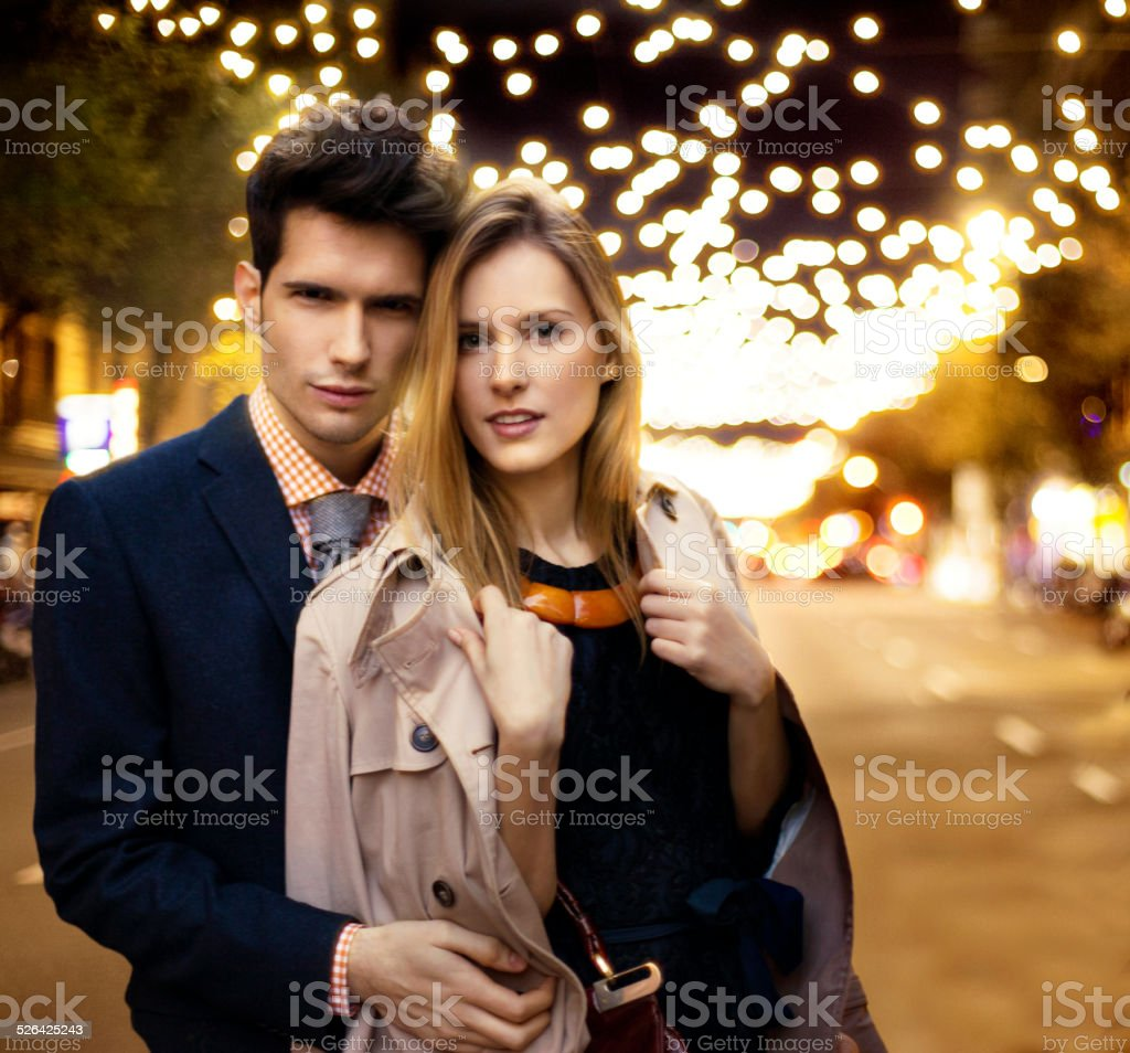 Couple with Christmas lights stock photo