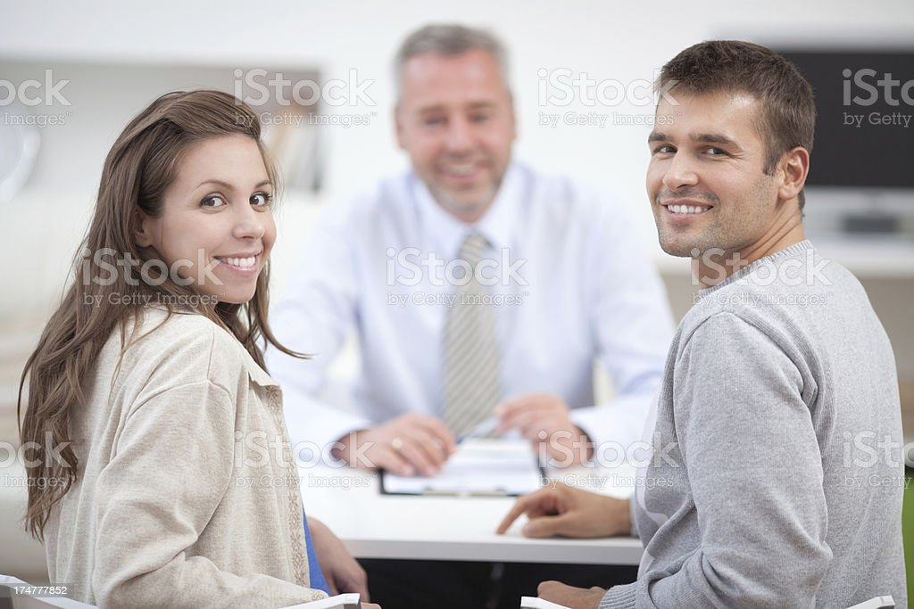 Couple with consultant. royalty-free stock photo