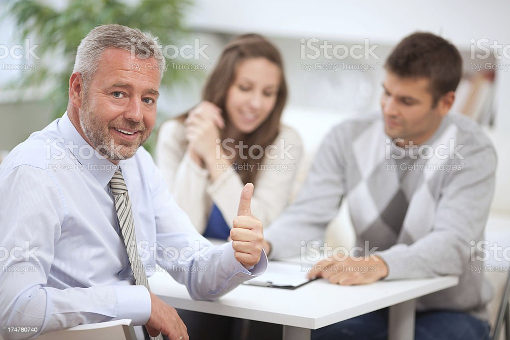 Couple with consultant royalty-free stock photo