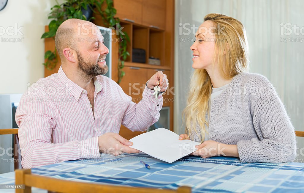 Couple with contract for buying apartment stock photo