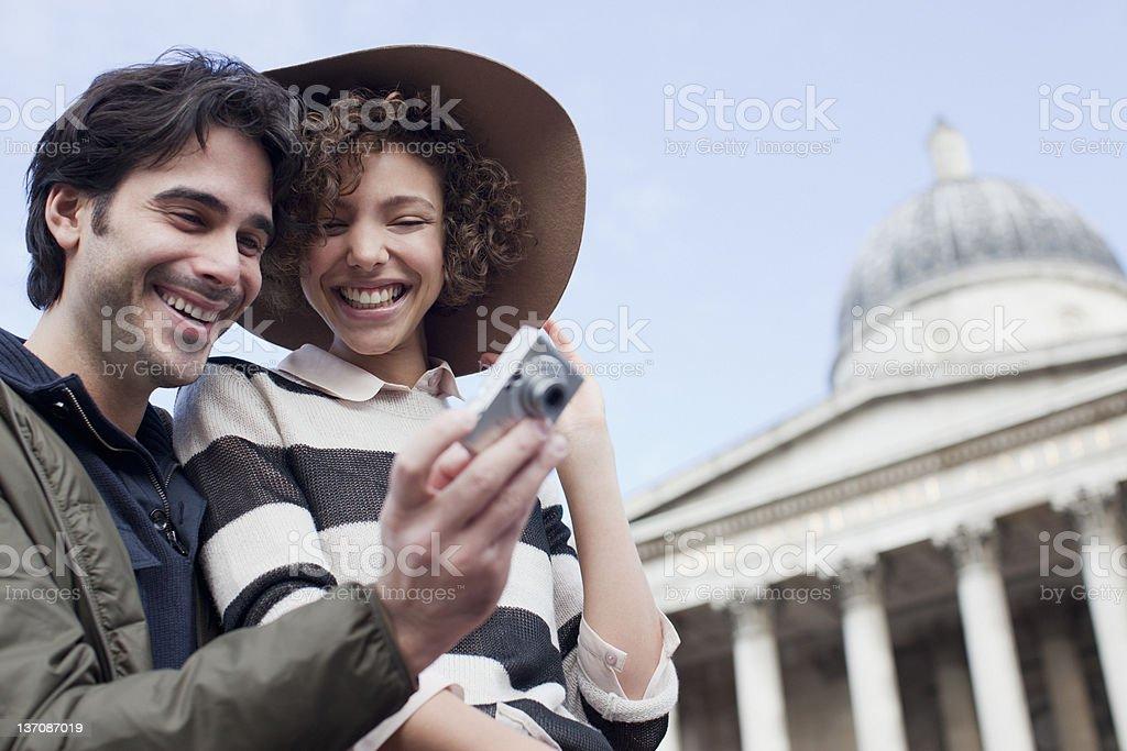 Couple with digital camera near historical landmark royalty-free stock photo