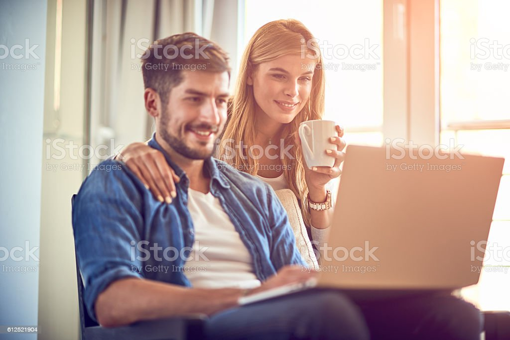 Couple with digital laptop stock photo