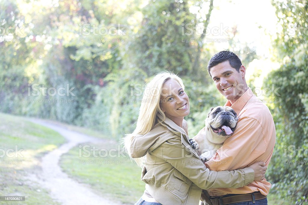 couple with dog royalty-free stock photo