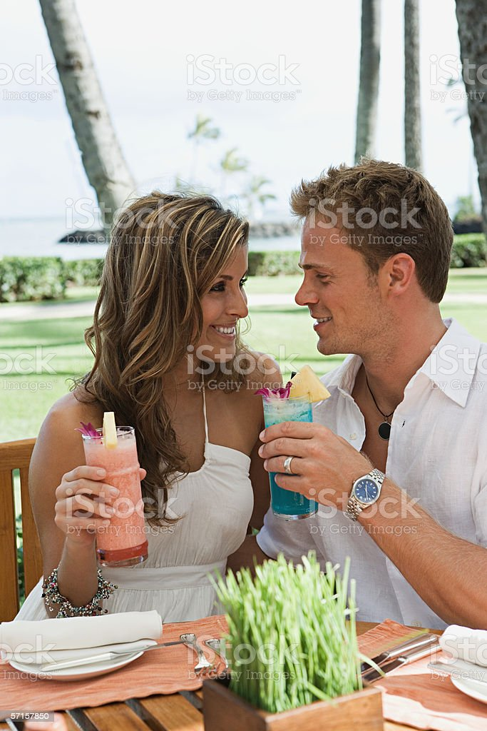 Couple with drinks royalty-free stock photo