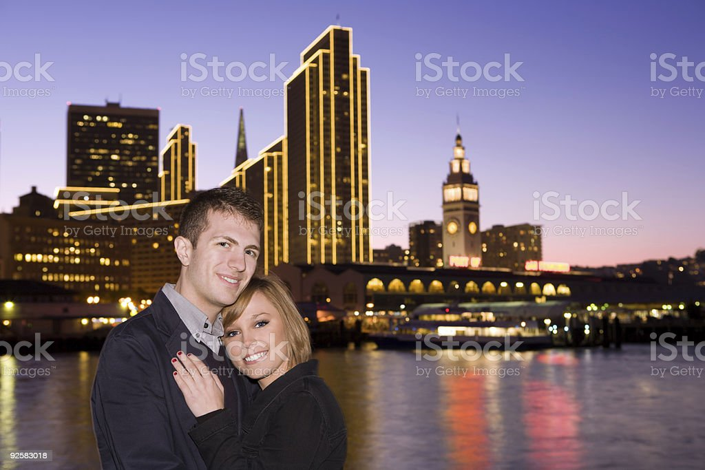 Couple with Ferry Building at night royalty-free stock photo