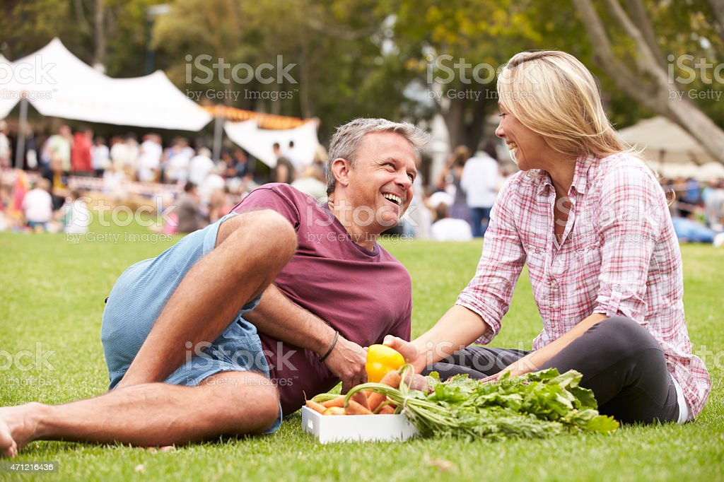Couple With Fresh Produce Bought At Outdoor Farmers Market stock photo