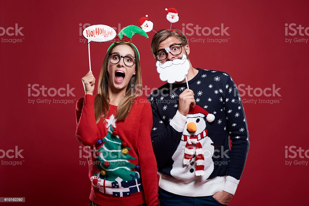 Couple with funny christmas masks stock photo