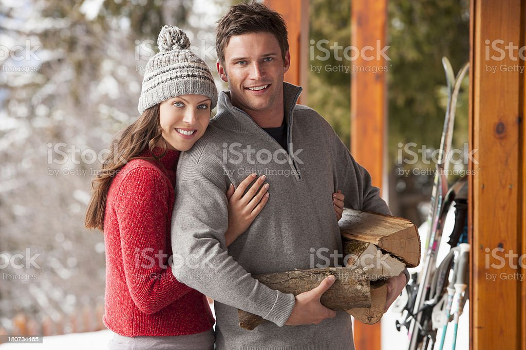 Couple With Guy Holding Logs royalty-free stock photo