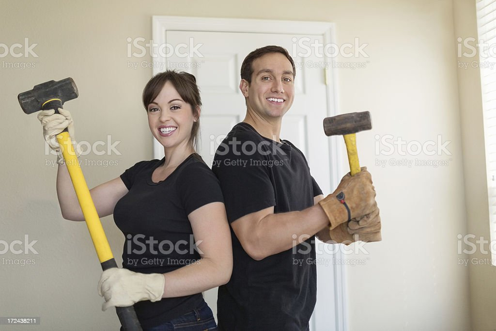 Couple With Hammers Standing Together royalty-free stock photo