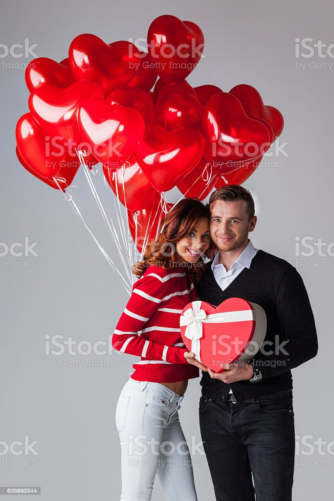 Couple with heart shaped balloons stock photo