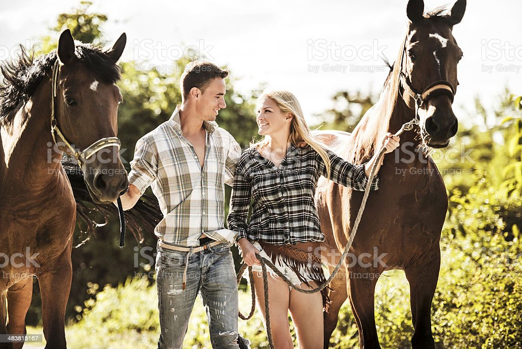 Couple with horses. stock photo