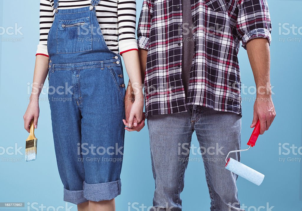 Couple with house painting accessories royalty-free stock photo