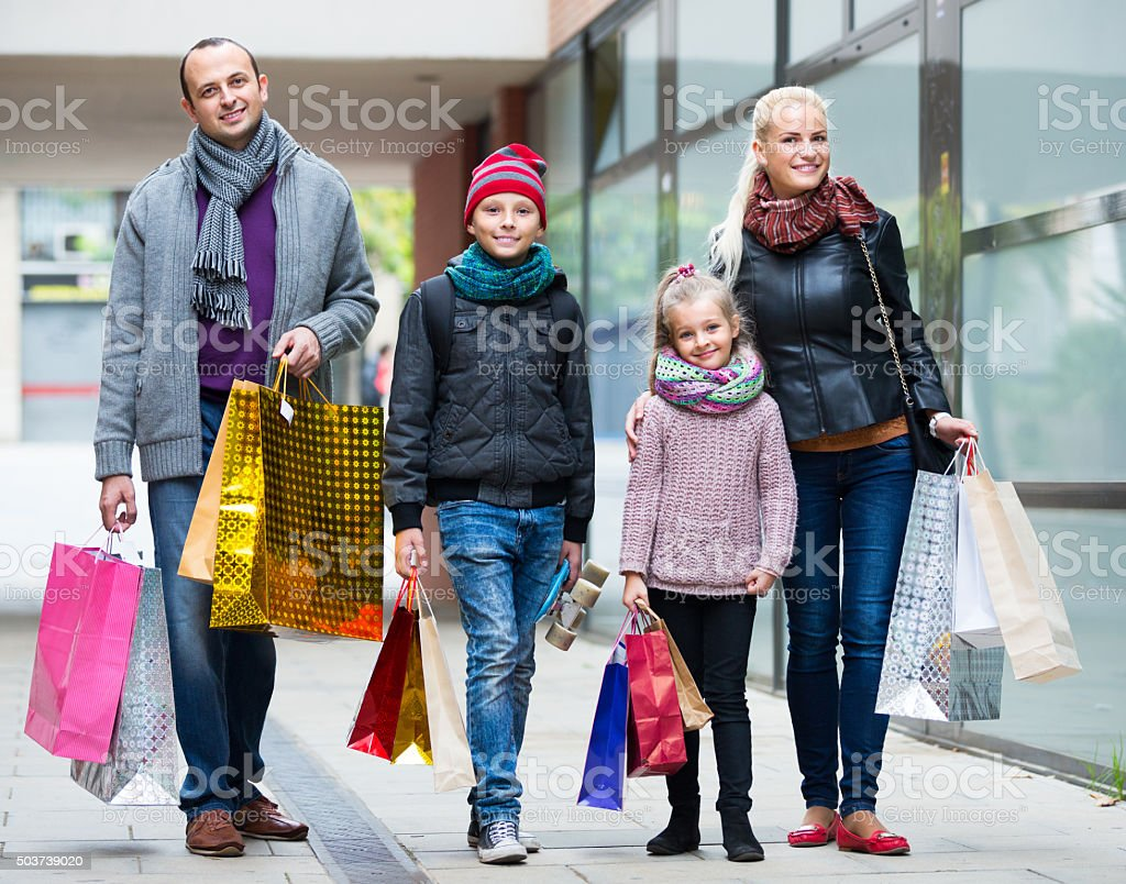 couple with kids on city street stock photo