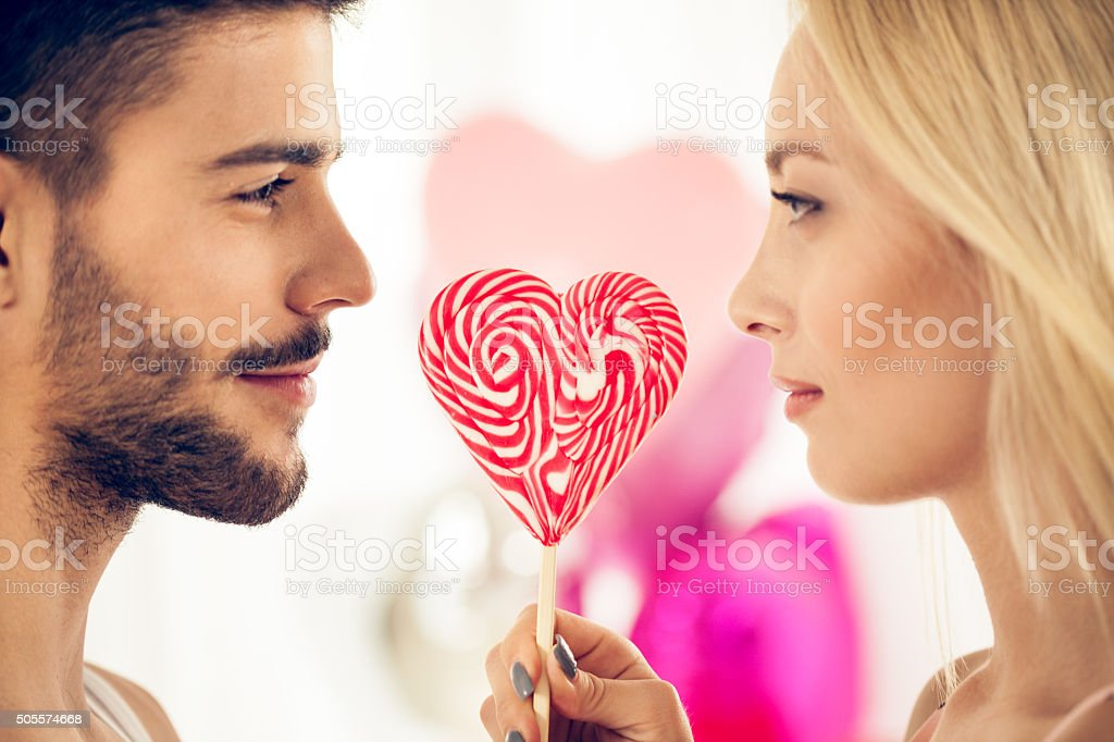 Couple with lollypop stock photo
