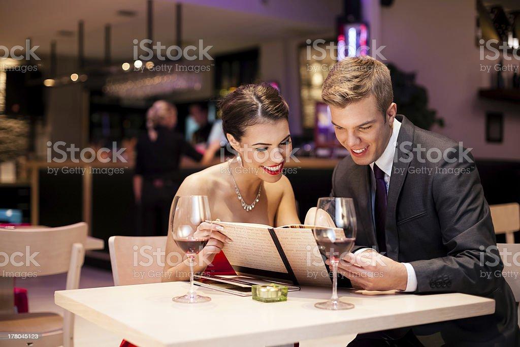 couple with menu card stock photo