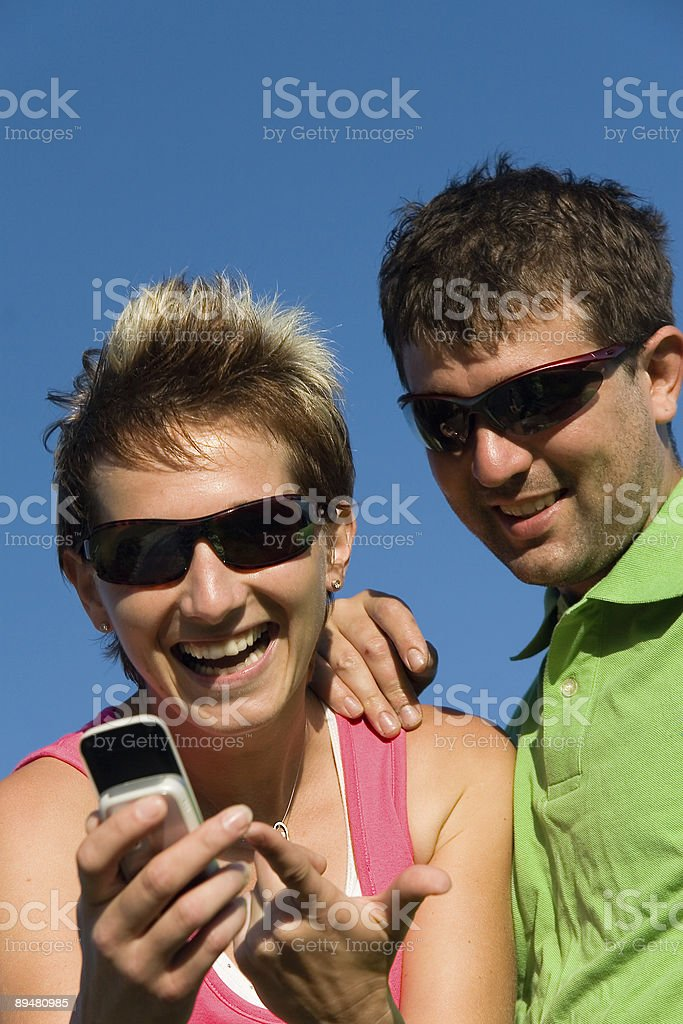 couple with mobile royalty-free stock photo