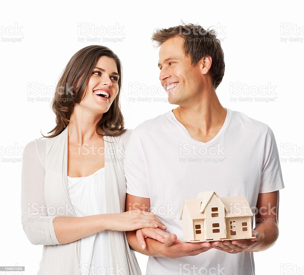 Couple With Model House - Isolated royalty-free stock photo