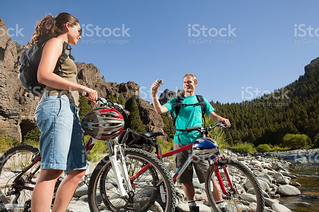 Couple with mountain bikes and camera royalty-free stock photo